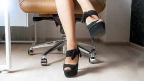 Sexy seductive woman with long legs sitting in boss chair at office. Sexy woman with long legs sitting in boss chair at office Stock Photography