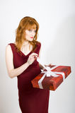 Sexy seductive woman with red present Stock Images