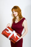 Sexy seductive woman with red present Royalty Free Stock Photos