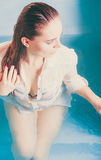 Sexy seductive woman in water. Sexy seductive woman in swimming pool water. Pretty alluring young girl Stock Images