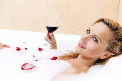 and Sensual Blond Female Relaxing in Foamy Bath Stock Photo