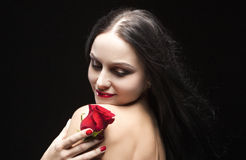 Sexy Sensual Brunette Woman Posing With red Flower in Studio Against Black Stock Photos