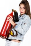 Sexy sensual female firefighter with a red fire extinguisher Stock Image