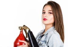 Sexy sensual female firefighter with a red fire extinguisher Stock Photos