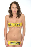 Sexy Sensual Naked Young Pin Up Woman Wearing Yellow Caution Tap Royalty Free Stock Photo