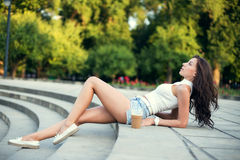 Sexy sensual woman posing at evening sunlight in city park Royalty Free Stock Photo