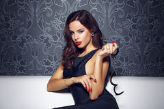 Sexy sensual woman with red lips holding handcuffs Royalty Free Stock Photos
