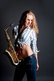 Sexy sensual young pretty blonde with sax Royalty Free Stock Photos