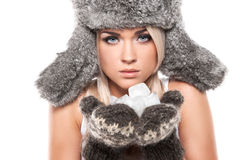 Sexy serous blond woman in winter warm hat. Stock Images