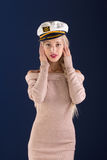 Sexy ship captain. Sexy blonde with long hair in a beautiful dress and captain's cap Royalty Free Stock Photo