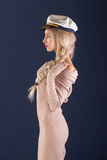 Sexy ship captain. Sexy blonde with long hair in a beautiful dress and captain's cap Stock Image