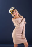Sexy ship captain. Sexy blonde with long hair in a beautiful dress and captain's cap Stock Photo