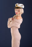 Sexy ship captain. Sexy blonde with long hair in a beautiful dress and captain's cap Stock Photos