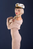 Sexy ship captain. Sexy blonde with long hair in a beautiful dress and captain's cap Royalty Free Stock Photos