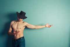Sexy shirtless cowboy pointing Stock Image