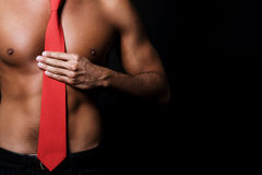 Shirtless man body. Shirtless man with red tie royalty free stock photography