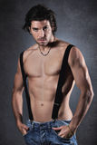 Sexy shirtless man with suspenders Royalty Free Stock Photo