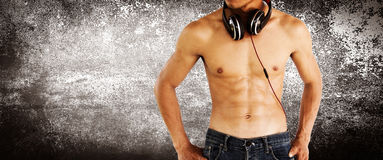 Sexy shirtless muscular male model with headphone Royalty Free Stock Photography