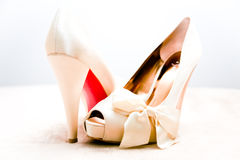 Sexy Shoes. A pair of feminine and sexy high heeled shoes against a light background Royalty Free Stock Photos