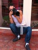 Shooting Girl. View of a shooting girl photographer royalty free stock photos