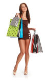 Sexy shopping girl. Sexy young woman with colorful shopping bags. consumerism concept Stock Photos