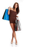 Sexy shopping girl. Sexy young woman with colorful shopping bags. consumerism concept Stock Images