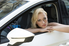 Sexy shopping girl in a car Stock Photo