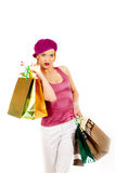Sexy shopping woman with lots of multi-colored bag Royalty Free Stock Photography