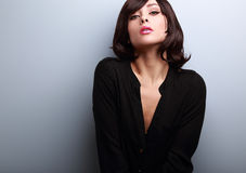 Sexy short hair female model posing in black shirt Royalty Free Stock Image