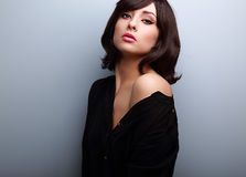 Sexy short hair female model posing in black shirt Stock Photography