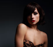 Sexy short hair woman with bright makeup on dark background Stock Photo