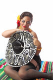 Sexy Shy Mexican Pin Up Girl. Beautiful Mexican pin up girl covering herself with a sombrero Stock Photo