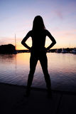 Sexy in Silhouette. A sexy woman standing by water, silhouette Royalty Free Stock Photography