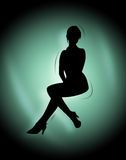 Sexy silhouette. Sexy lady silhouette on a gradient background Stock Image