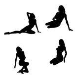 Sexy silhouetten van een vrouwenzitting Stock Foto's