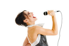 Sexy singer woman. With microphone isolated over white background Royalty Free Stock Photography