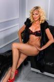 Sexy slim blond woman posing in modern luxury interior Stock Photos