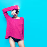 Sexy slim blonde girl on blue background Royalty Free Stock Image