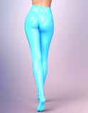 Sexy slim female legs in light blue latex pantyhose. Royalty Free Stock Image