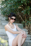 Sexy slim lady wear tight short white dress and sunglasses Stock Images