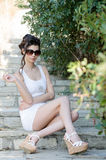 Sexy slim lady wear tight short white dress and sunglasses Royalty Free Stock Photos