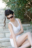 Sexy slim lady wear tight short white dress and sunglasses Royalty Free Stock Image