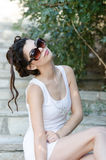 Sexy slim lady wear tight short white dress and sunglasses Stock Image