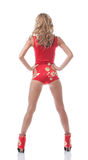 Sexy slim model in red suit posing back to camera. Isolated on white Stock Photo