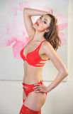 Sexy slim model wearing red lingerie Royalty Free Stock Image
