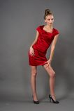 Sexy slim woman in red dress Royalty Free Stock Photography