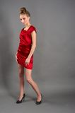 slim woman in red dress Stock Photos