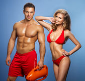 Sexy smile couple rescuers Of Water Stock Image