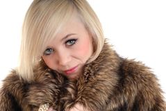 Sexy smiling blond wearing fur coat Royalty Free Stock Photo
