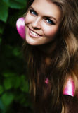 Sexy smiling blond woman on nature. Sexy smiling blond woman with blue eyes on nature Stock Photo